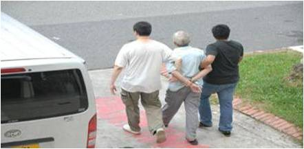 CNB officers arresting a drug suspect on 30 May 2013