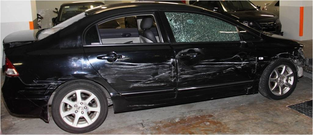 The damaged vehicle that the suspect used to evade arrest