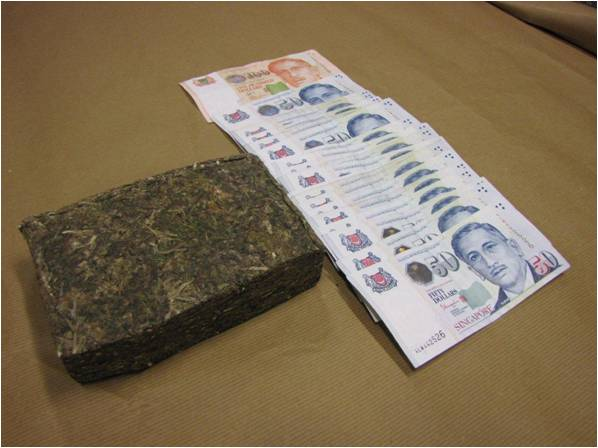Cannabis and cash seized in a CNB operation at Ang Mo Kio on 12 Feb 2014.