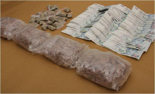 Drugs and cash seized from CNB operation on 25 June 2014.