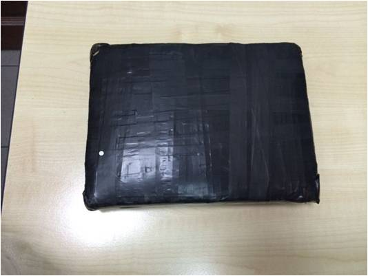 Black bundle found inside bag carried by 36-year-old male Singaporean suspect