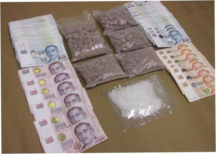 Heroin, 'Ice' and cash seized in a CNB operation on 6 Feb 2014.