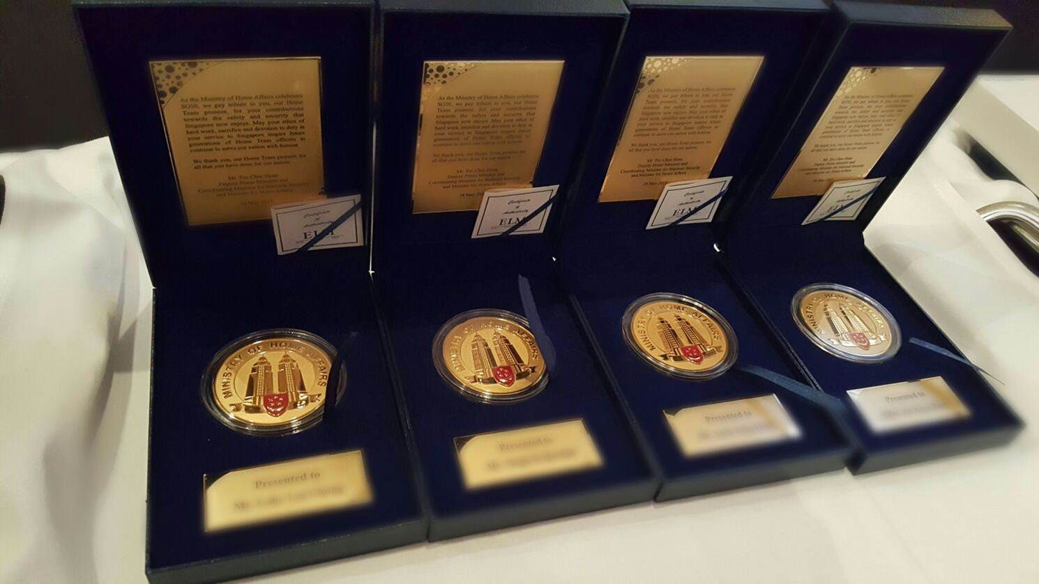 Photo 2: SG50 Medallions given out to CNB pioneers during the CNB Appreciation Dinner 2015