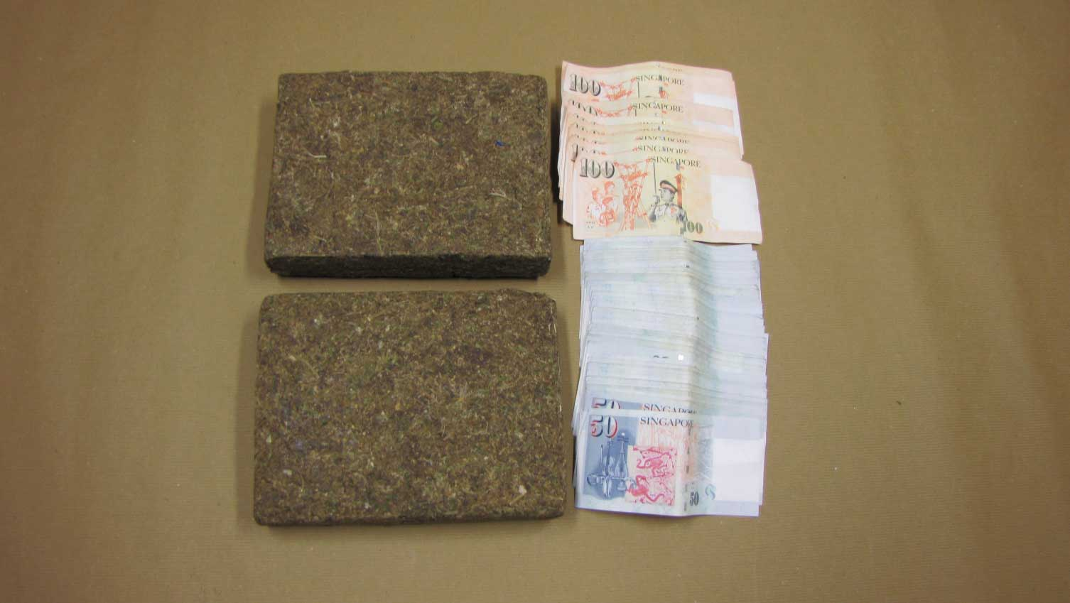 Photo 3: The cannabis and cash that was seized in CNB's operation on 26 Nov 2015