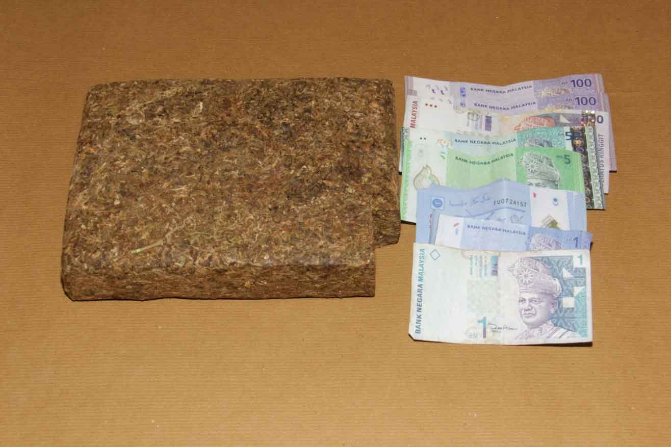 Photo 2: Block of cannabis and cash found in the van of the 35-year-old suspect