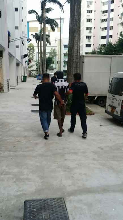 Photo-6 : CNB officers escorting a suspect arrested in CNB operation from 5-8 Oct 2015