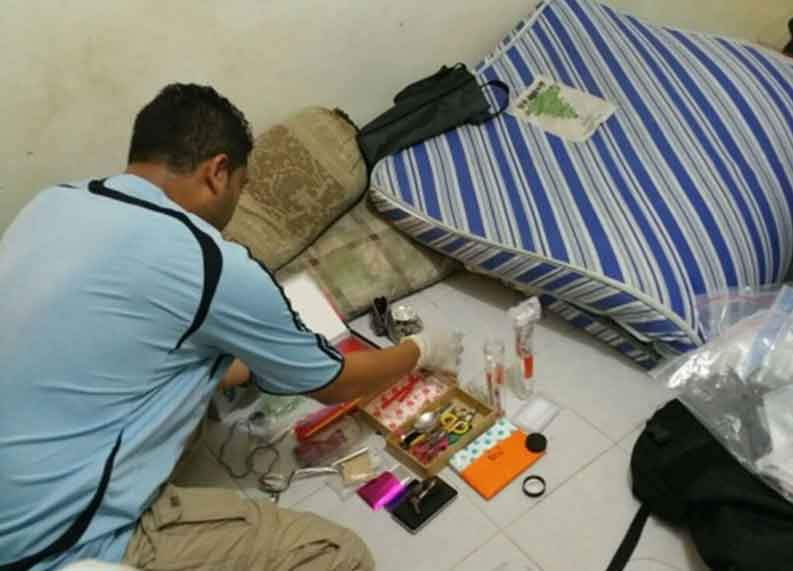 Photo-5 : CNB officer going through seized exhibits in CNB operation from 5-8 Oct 2015