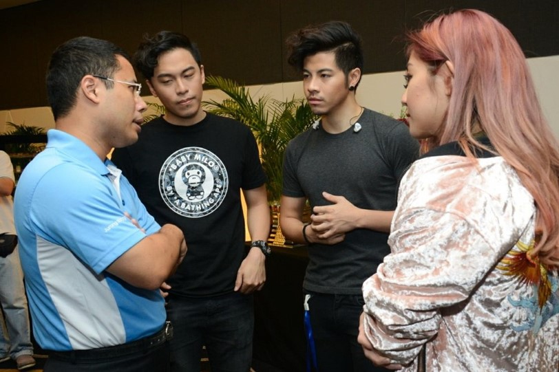 Photo 1: Second Minister for Home Affairs and National Development, Mr Desmond Lee, interacting with members of The Sam Willows.