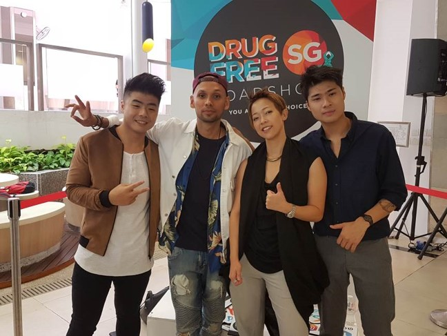 Photo 4: Scarlet Avenue, THELIONCITYBOY and Ruth Ling at the photo booth at CNB's anti-drug roadshow.