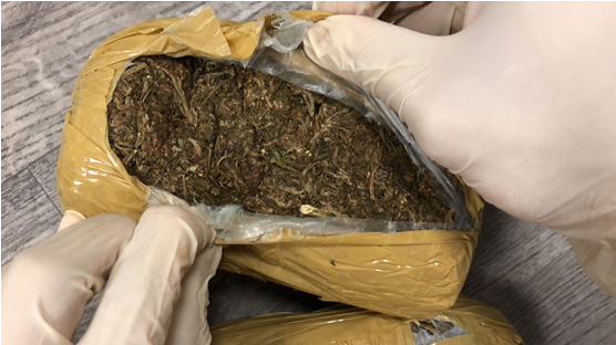 Photo-2 (CNB): Close-up view of cannabis found concealed in box labelled as containing food items, recovered from a male foreign national on 9 July 2018.