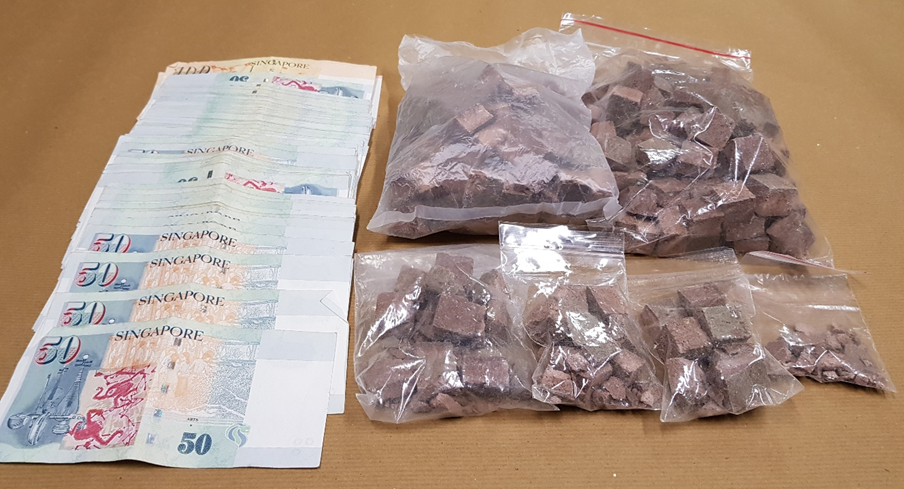 Photo-2 (CNB): Heroin and cash seized in CNB operation on 21 June 2018