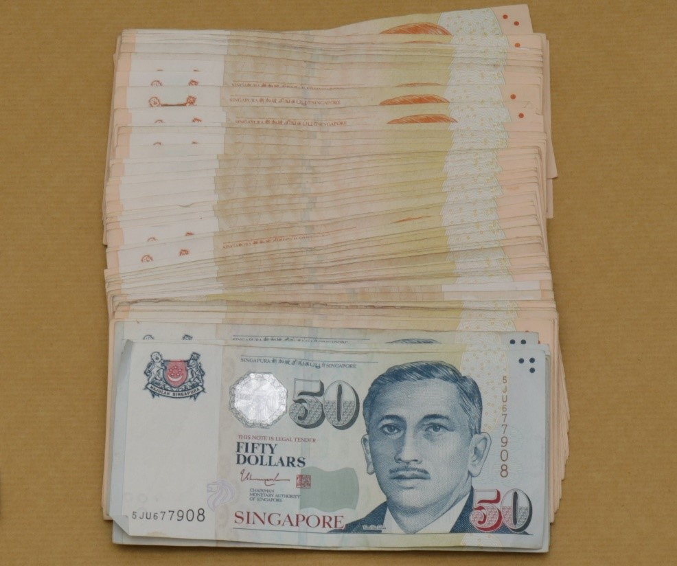 Cash seized from CNB operation at Woodlands Street 13 on 11 Dec 2019