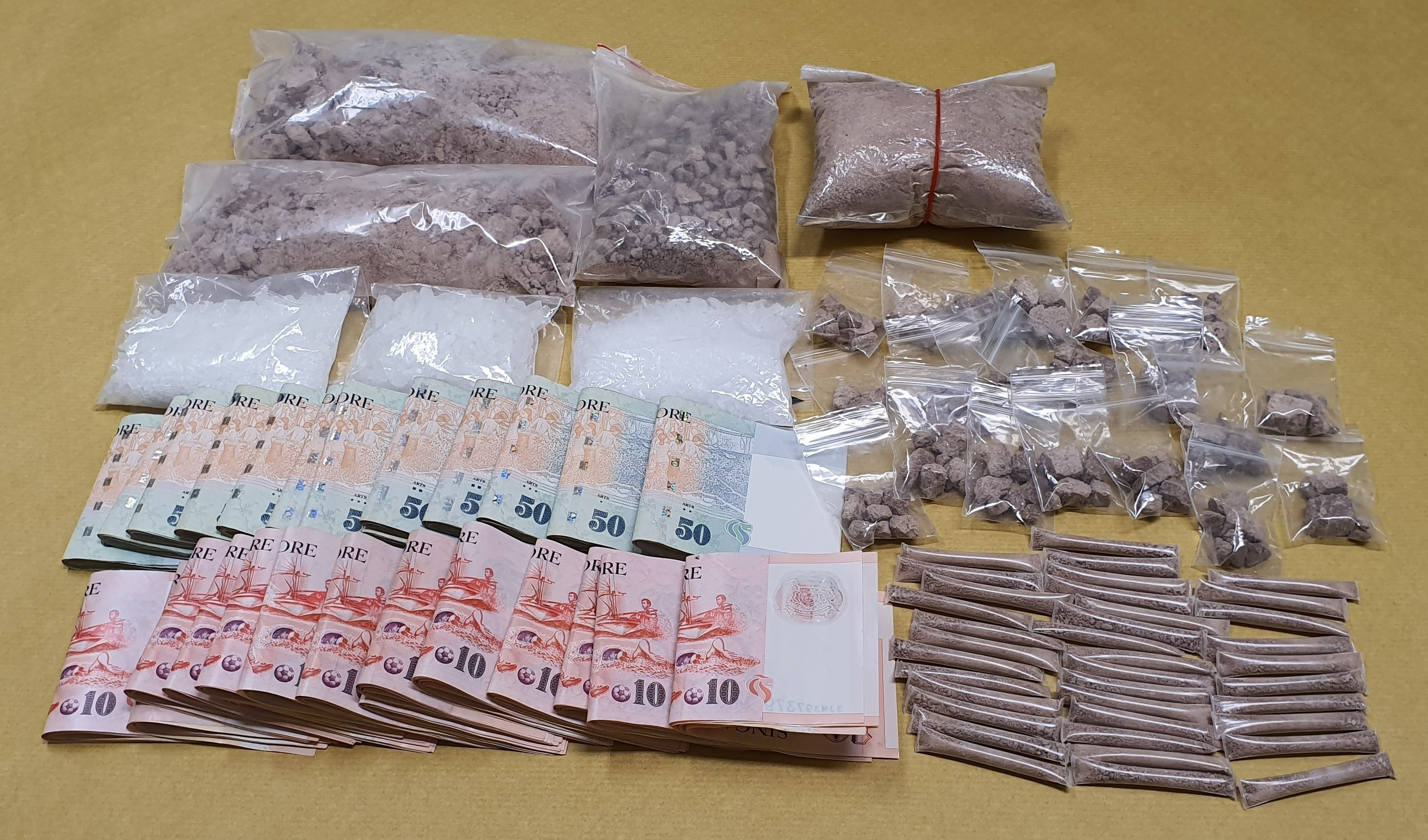 Photo-1 (CNB):  Drugs and cash seized from 54-year-old suspected drug trafficker and from within his residential unit, during CNB island-wide operation from 23 to morning of 27 September 2019.