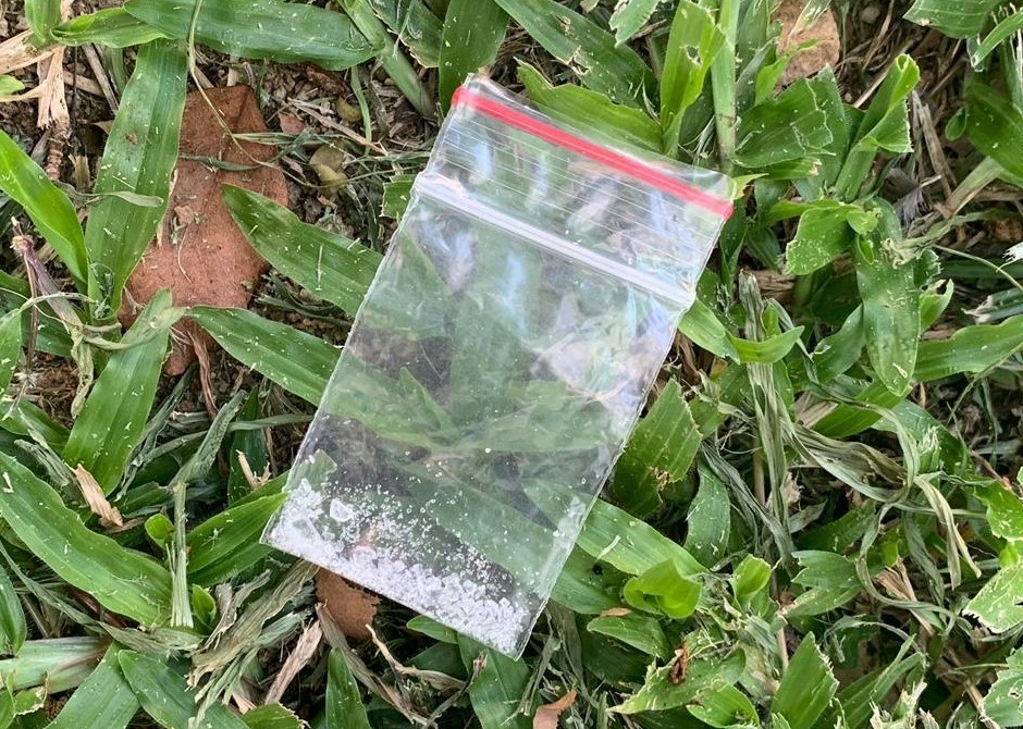 Photo-1 (CNB):  Small packet of 'Ice' found on grass patch, in CNB raid on a unit at Fajar Road on 11 September 2019.