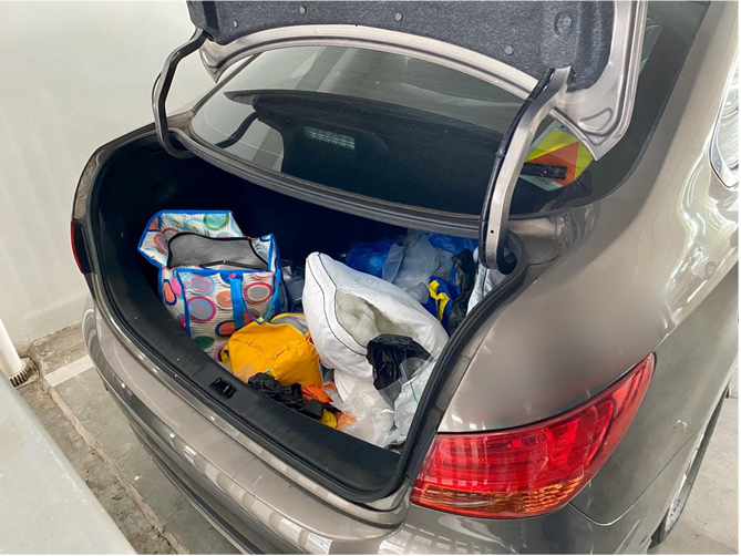 "View of boot of car parked at multi-storey carpark in vicinity of Woodlands Drive 50, which acted as a ""mobile drug store""."