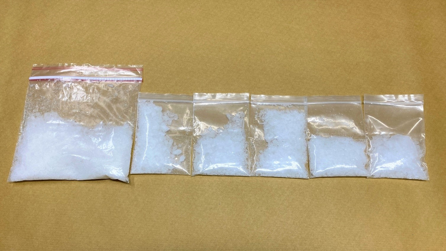Photo 1:Packets of 'Ice' recovered in the vicinity of Sumang Lane during a CNB operation on 23 November 2020